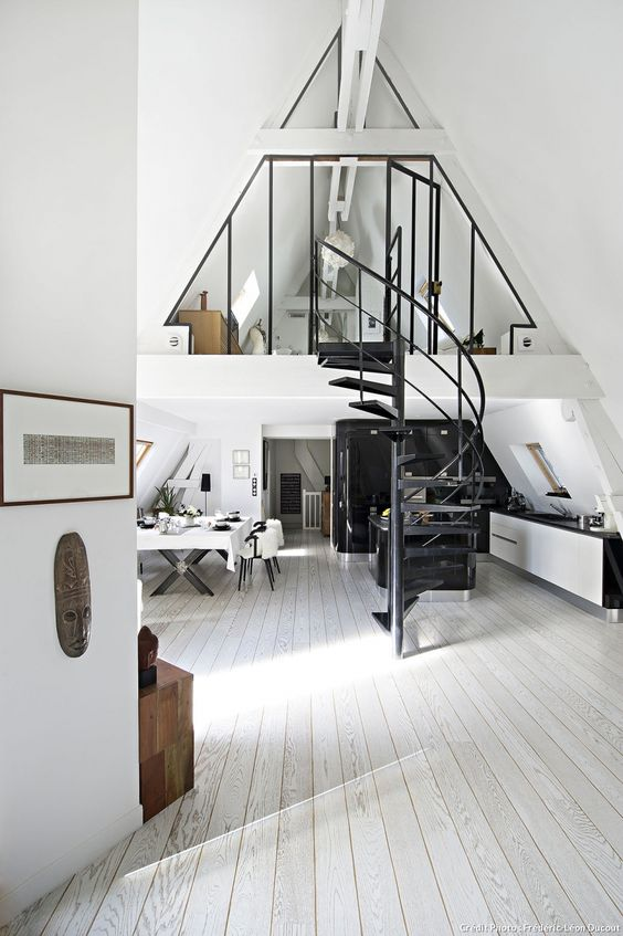Loft in Paris kitchen and dining room in black and white.  Love the spiral staircase in the middle.:
