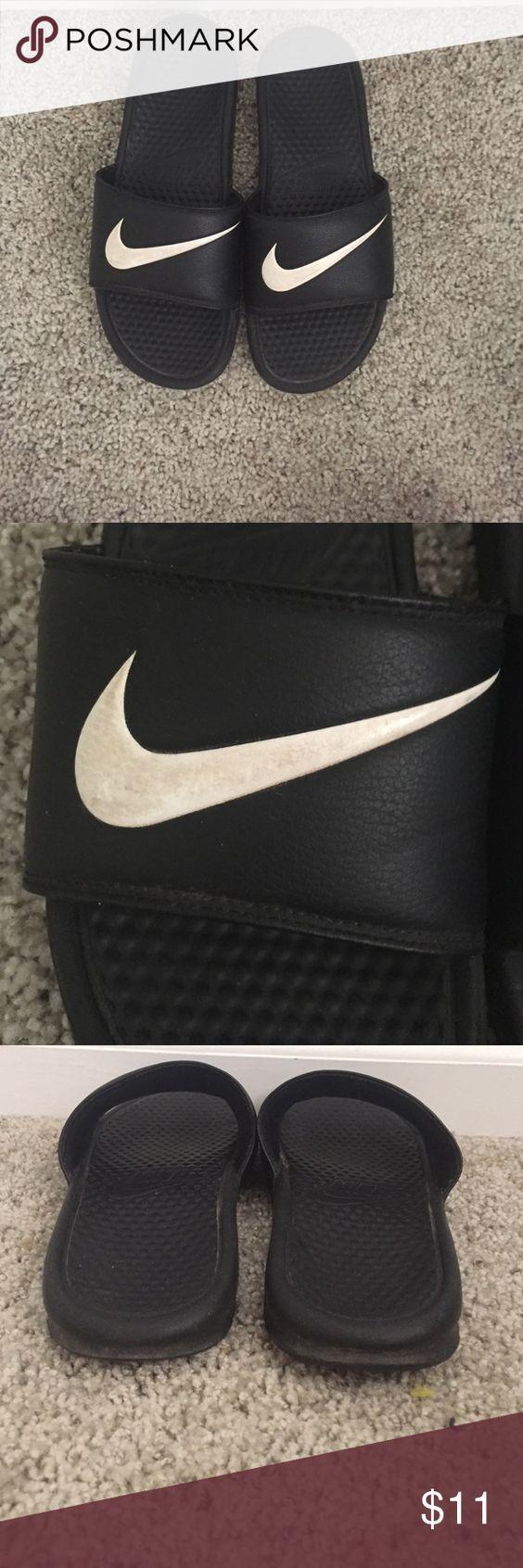 Nike slides men's size 9 Black nike slides with a white swoosh. The white  swoosh