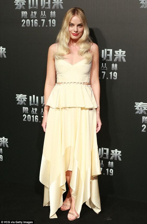 Head turning: Margot Robbie couldn't be faulted on her latest head turning ensemble during the premiere of The Legend Of Tarzan in Beijing on Thursday