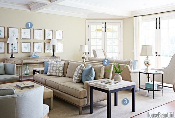 """""""Avoid the urge to push all the furniture up against the walls. Floating items out into the room can help you make use of all the available square footage."""" —Libby Langdon: 1. Grouped Artwork 2. Back-to-Back Sofas 3. One Big Rug"""