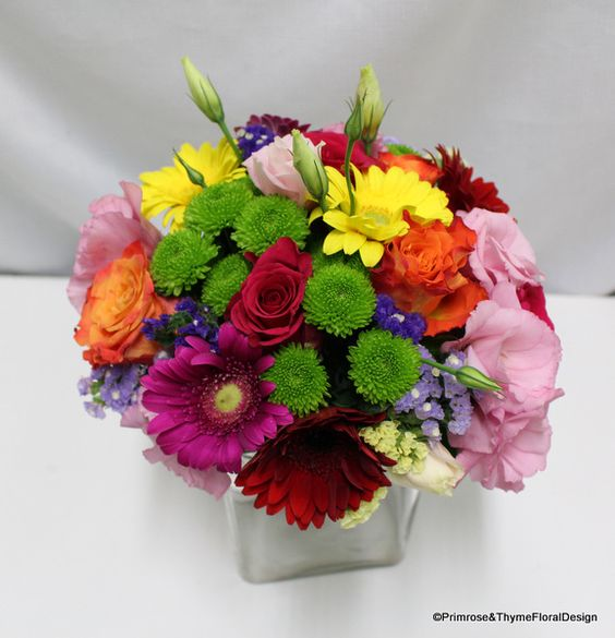Colourful mixed wedding bouquet for your bridesmaid or flower girl, using roses, green button chrysanthemums, lisianthuses, gerberas and purple statices