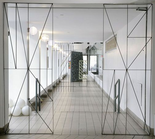 Metal Partition Walls : Thin metal lines geometric framing of a partition door