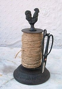 http://i.ebayimg.com/t/Cast-Iron-Rooster-Twine-Holder-with-Scissors-Store-Accessories-to-Wrap-Packages-/00/s/MTQwMlg5ODQ=/$(KGrHqVHJCkFCZ(Ep,DPBQoEoW)o3Q~~60_35.JPG