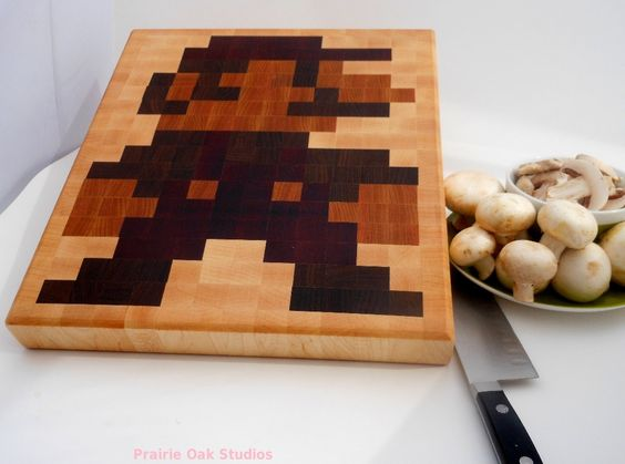 Preorder: 8 bit Mario end grain cutting board. $110.00, via Etsy.