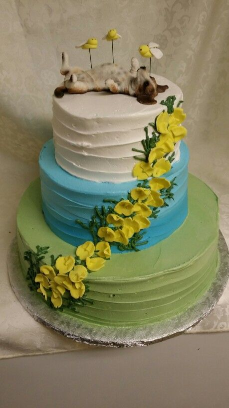 Doggie topper, sugar bumblebees and gorse flowers on this non traditional wedding cake.