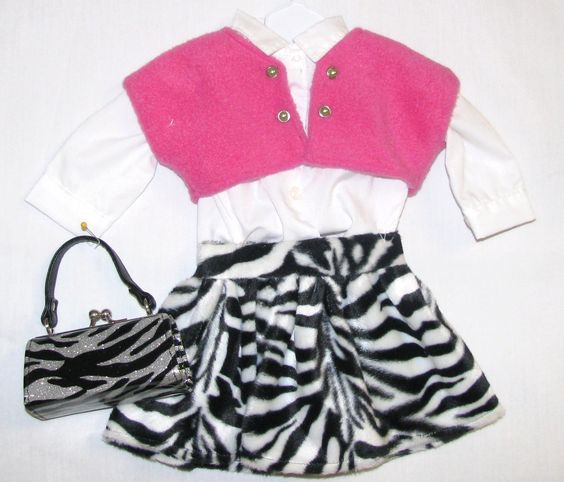 "$28  set of clothes for 18"" American Girl Doll.  Long sleeve white blouse, fleece zebra skirt and hot pink lined vest.  Also has a metallic snap closure 3"" long purse. Facebook:  Fairy Tales Louisiana Made, Peggy Callegari. Thanks for looking!!"