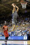 Duke's Mason Plumlee (5) dunks past Maryland's James Padgett (35)