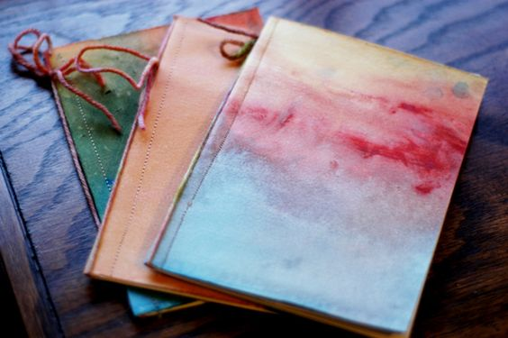 watercolor-covered sketch books