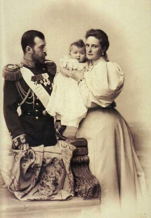 "Tsar Nicholas ll of Russia and Empress Alexandra Feodorovna of Russia with their firstborn,the Grand Duchess Olga Nikolaevna Romanova of Russia.  ""AL"""