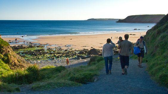 People walking towards Marloes Sands
