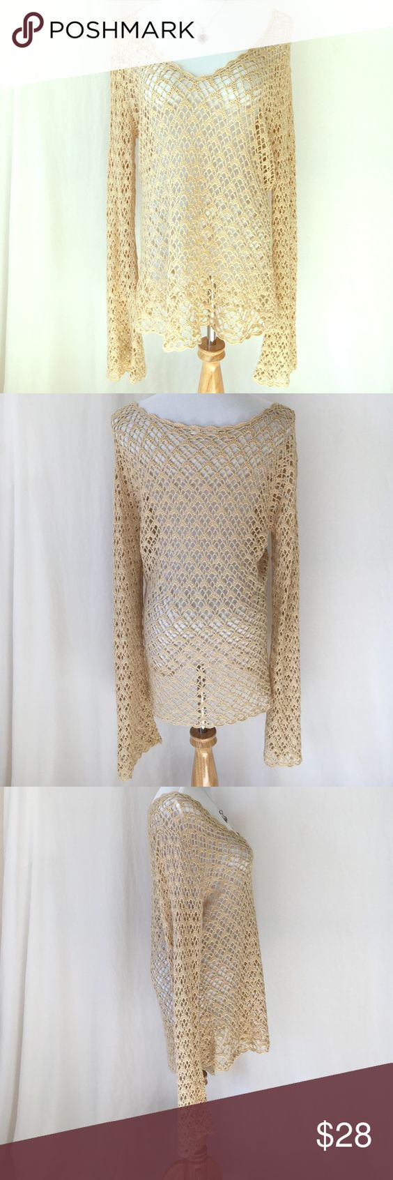 """Tan Gold Crochet Sweater This lovely tan crochet sweater has gold thread running through it... Extra long bell shaped sleeves and V-neck makes this sweater extra hip! Quite Large and roomy. Length: 28"""". Sleeve Length: 30"""". Bust: 44"""". All reasonable offers accepted: ) 🌻 Stamp 10 Sweaters V-Necks"""