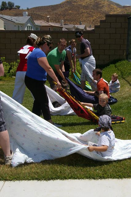 The blanket run is a fun outdoor family game.