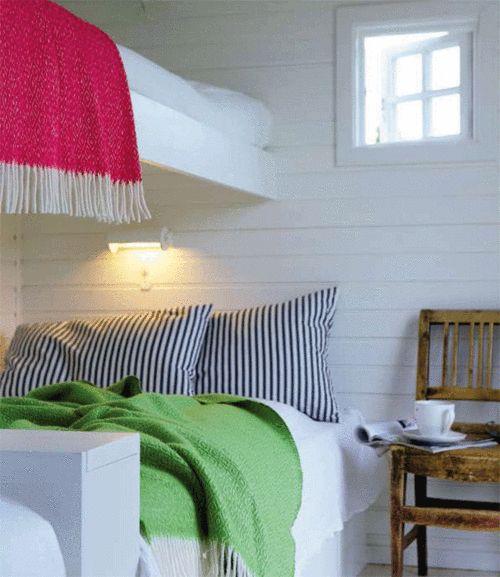 bunks. pillows. chair as a bedside table.