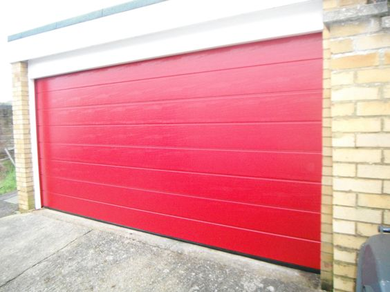 Hormann m ribbed sectional garage door in red with white for Upvc garage doors