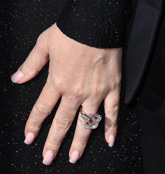 The First Look of Mariah Carey Wearing Her Massive Engagement Ring via @WhoWhatWear