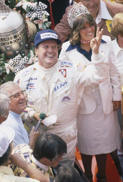News Photo : A.J. Foyt gestures with four fingers that this is...