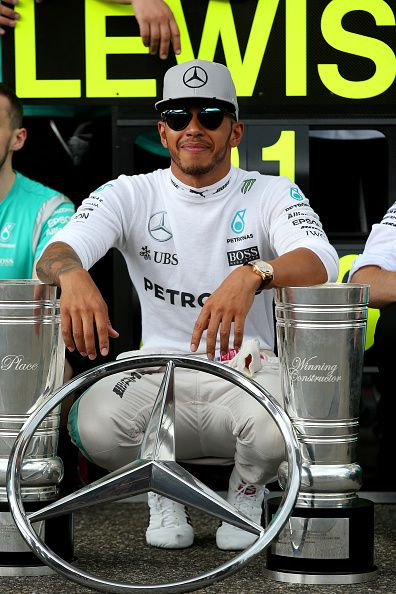 Lewis Hamilton of Great Britain and Mercedes GP celebrates with his team outside…