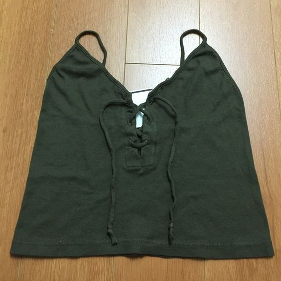 """Brandy Melville (John Galt) Olive Tank NWT Soft cotton ribbed knit tank in olive with a tie detailing front and a cropped fit 17"""" length, 13"""" bust Size: small Made in USA Color: Blue New with tag #400 N ******model picture in burgundy color***** Brandy Melville Tops Crop Tops"""