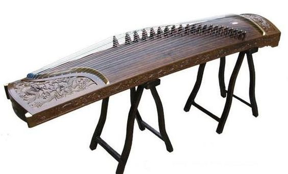 "The Zheng, commonly known as Guzheng, ( pronounced ""Goo ..."