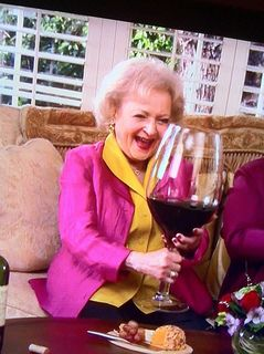 Betty White likes wine ...BIG Glasses!!
