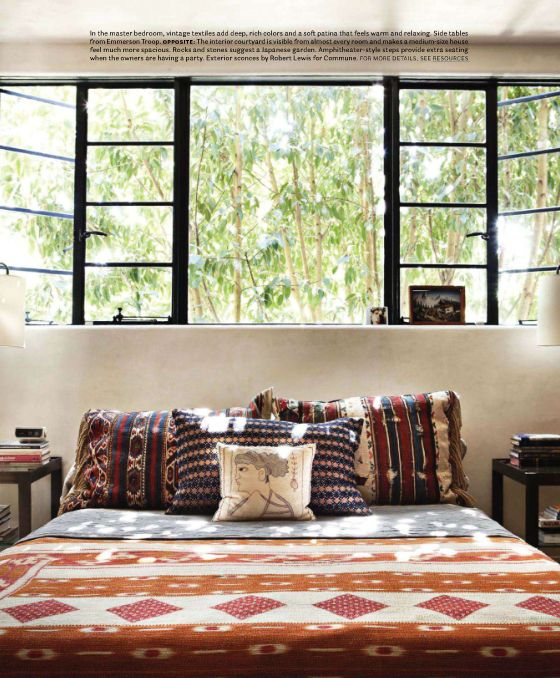 The windows perfectly balanced above bed + window frame dark contrast frames the outdoors