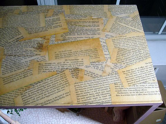 Decoupage with old book pages. Good idea for table tops, dressers, orbs, wood chairs, even walls & doors. Hmmm...??? Got some ideas now!