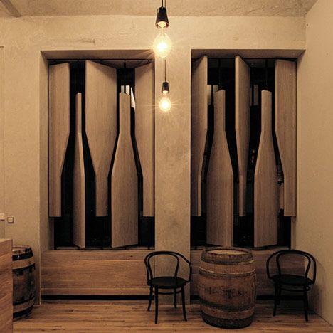 Bottle-shaped shutters in the window of a wine shop