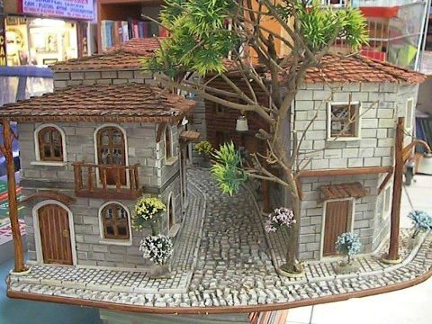 (Nux. Un Mundo Miniaturas) Oh wow... this is so beautiful. I could play in these shops for days and days.: