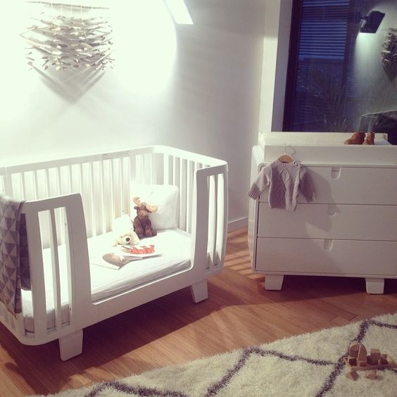 bloom's mid century modern inspired retro crib & dresser in coconut white creates a unique, clean and contemporary nursery