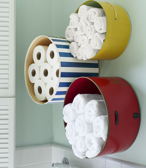 Paint hat boxes to create towel storage in a bathroom