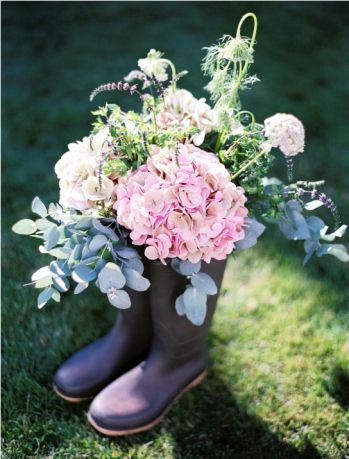 Such a fab idea! Decorate your venue with wellie boots overflowing with beautiful blooms