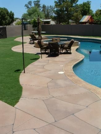 Stone Pool Deck.  CONCRETE ART transforms plain concrete in Southern California.