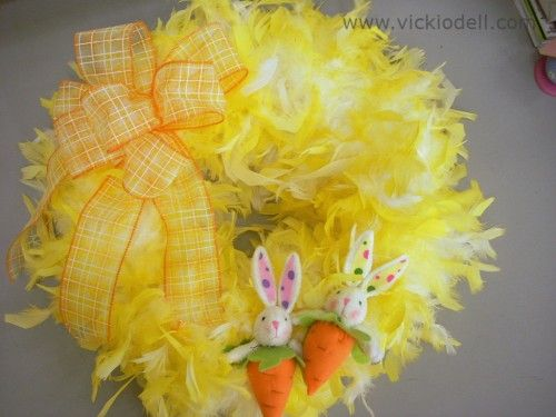 Turn white feather boas into a fluffy yellow Easter wreath!