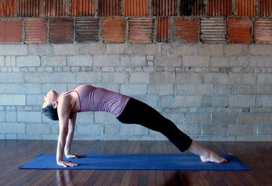 GET WOW ARMS WITH THIS YOGA SEQUENCE:  Intense East    Though Intense East looks easy, this pose really challenges your triceps and upper back, and for an added bonus, you'll also tone your tush and the backs of your legs.