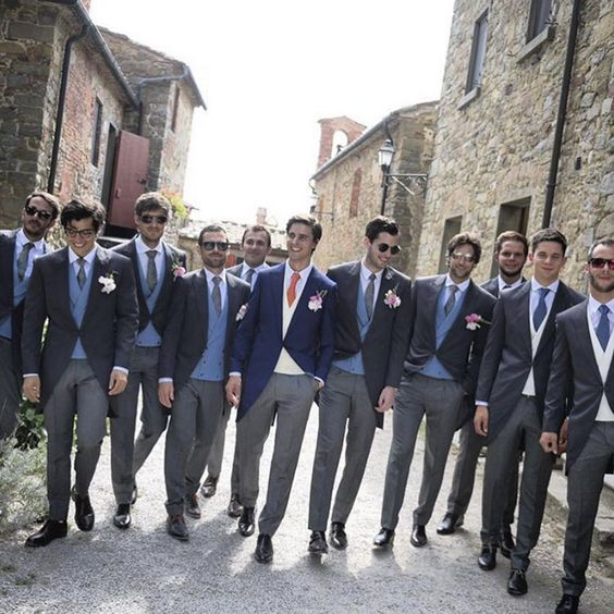 Groom and groomsmen in navy and grey suits // Filipino actress Isabelle Daza's destination nuptials at Castello di Gargonza, Italy {Facebook and Instagram: The Wedding Scoop}