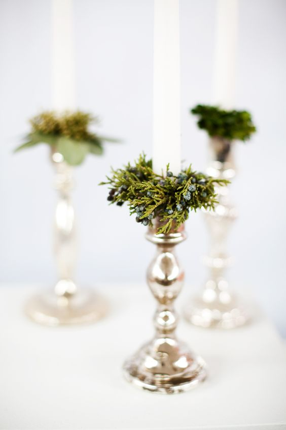 Evergreen and silver candle holders
