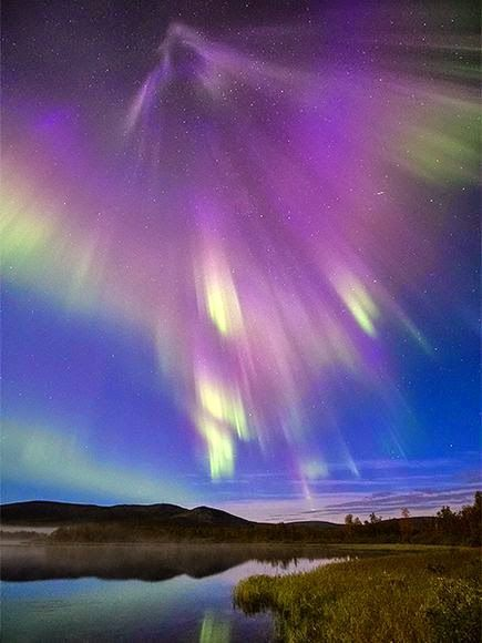 A supernova like burst of mostly purple auroras lights up Finnish countryside in a wide-angle sky shot. from Google+