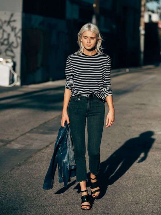 For a cute and simple spring style, wear a striped tee with jeans and sandals like Rima Vaidila. This look is virtually effortless, but will always afford you a stylish aesthetic!Jeans: Neuw, Jacket: Ganni, Heels: Freda Salvador.: