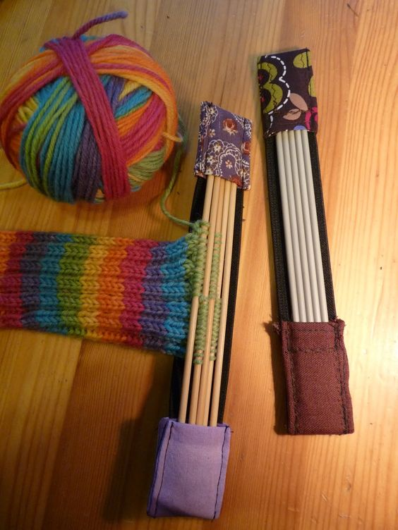 Piece of wide elastic, stitched pockets on end. Keep your needles together. Great idea!