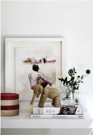 framed aquarelle and stacked objects.