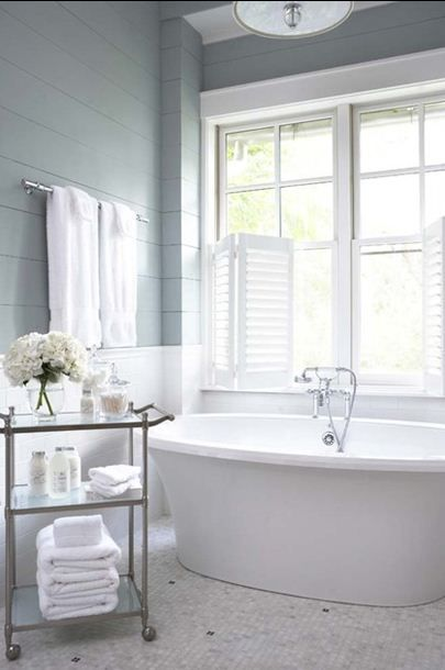 Gray and white grey bathroom with tub.