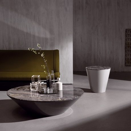 This surprisingly mobile Pond Table plays with the mind's perception in myriad ways. This low table features a wider, reflective glass table top and a matte lacquered structure that tapers below it.