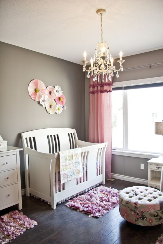 This DIY'd paper pinwheels (made from scrapbook paper and doilies) are such a sweet accent above the crib! #nursery