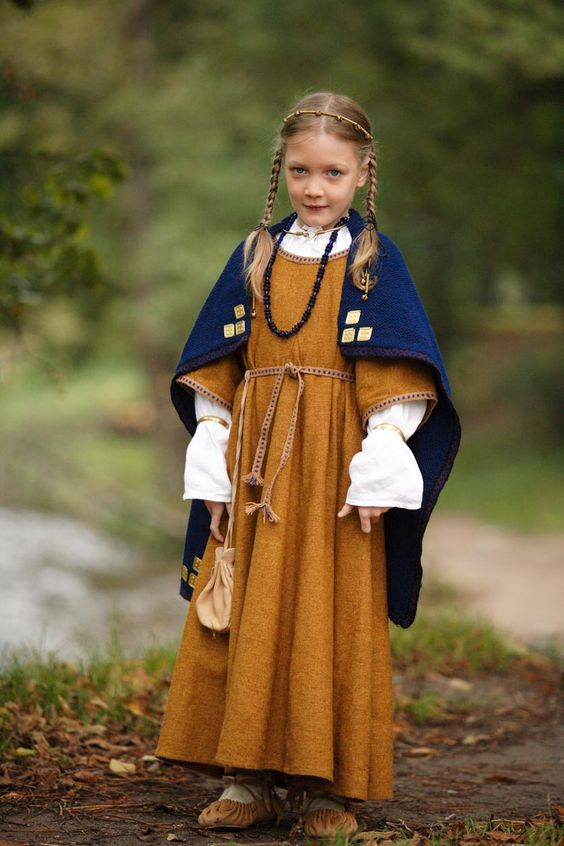 Lithuanian tribe child costume, Viking period (IX-XII century or Late Iron Age). Author - Daiva Steponaviciene:
