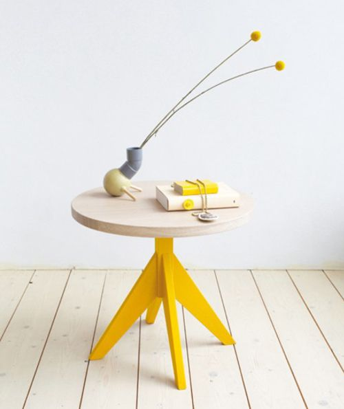 Love the simplicity of this Slow Wood table's shape and the pop of yellow that emphasizes the angles of its base.