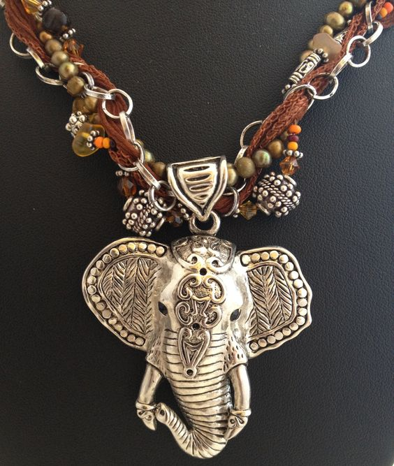 Recycled elephant pendant, chain and silk ribbon with recycled beads SOLD  Copyright Paradigma Jewelry 2012