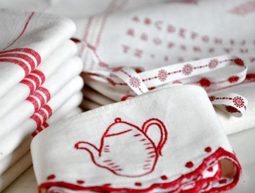 adorable red and white tea towels and embroidered trims    These would be perfect on IKEA dish towels.