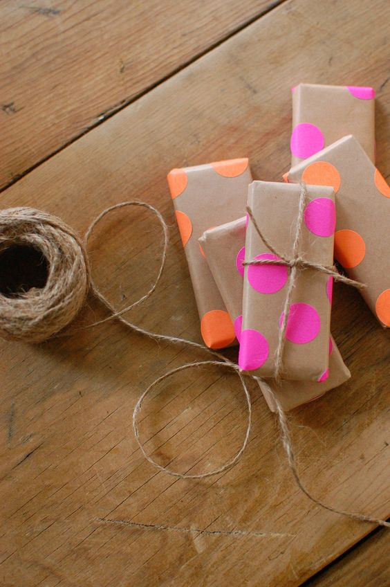 DIY gift wrap using neon office supply dots, kraft paper and twine.
