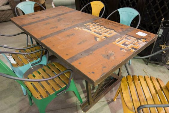 Industrial fun table and colorful chairs for the true Austinites personality