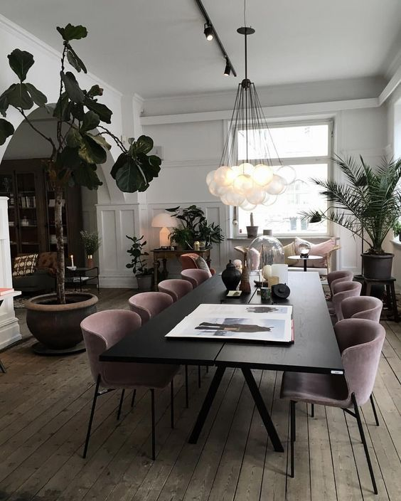 Modern Scandinavian Dining Room With Black Pink And Wooden